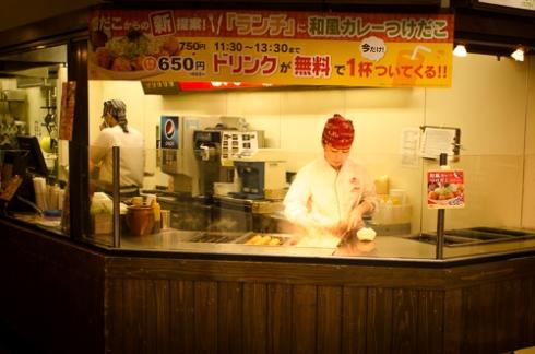 Street Vendor making one of my favorites - Takoyaki