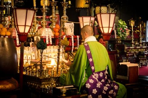 Monk Kneeling Before a Shrine